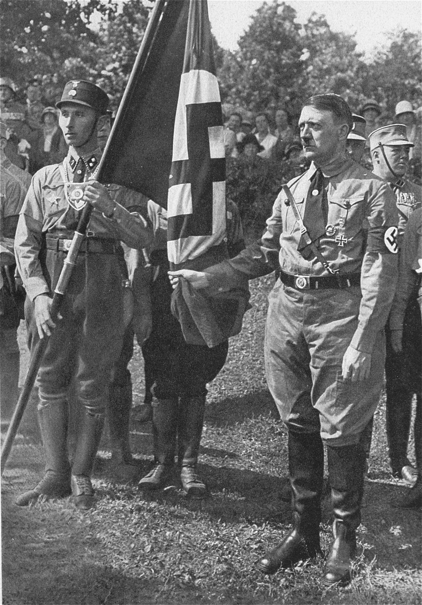 Adolf Hitler and Jakob Grimminger hold the Blutfahne at the 1929 RPT flag consecration