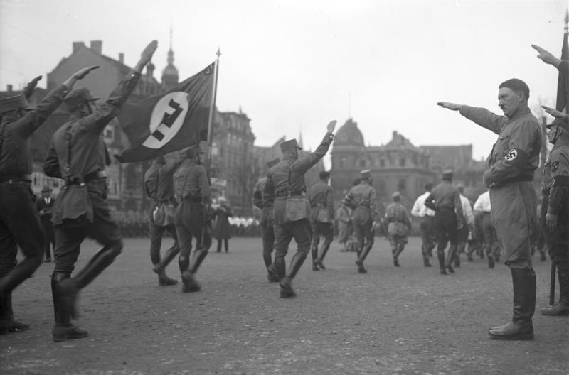 Adolf Hitler reviewing a Party rally in  Braunschweig
