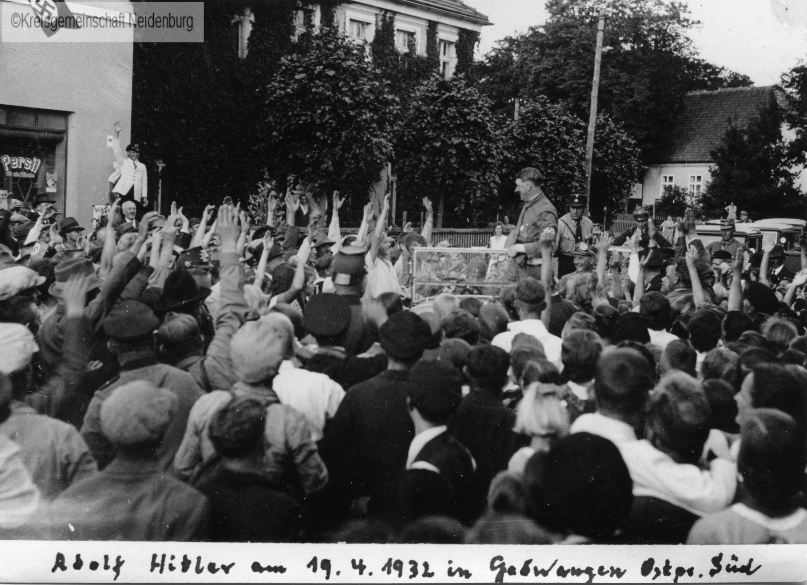 Adolf Hitler drives through Neidenburg