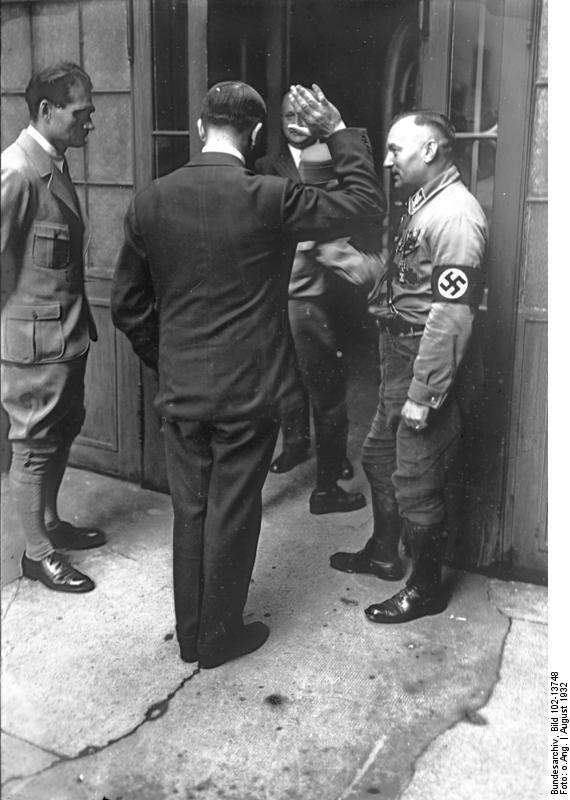 Adolf Hitler greets some Party members in Neubiberg
