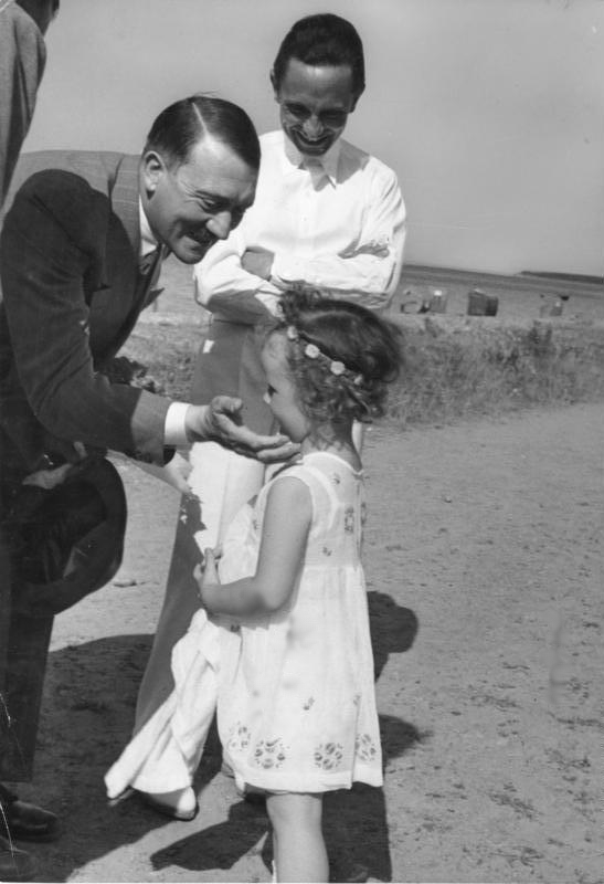 Adolf Hitler, Joseph Goebbels, and his daughter Helga on the beach in Heiligendamm