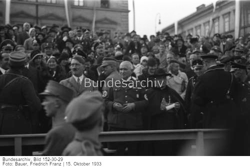 Adolf Hitler watches a parade at a ceremony to lay the foundation stone of the House of German Art, which will replace the Glass Palace