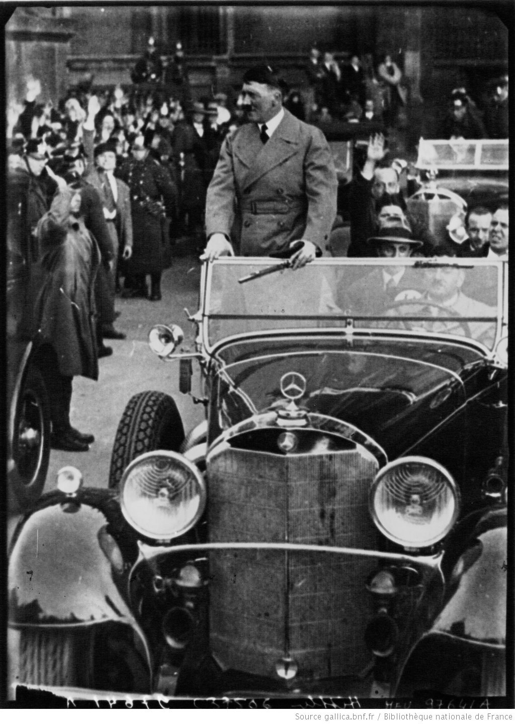 Adolf Hitler on his way to the Siemens factory to deliver a speech