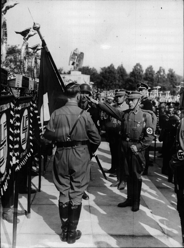 Adolf Hitler consecrating the standards in Nuremberg's Luitpoldhain