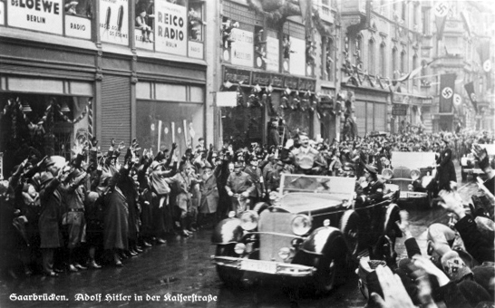Adolf Hitler crosses the streets of Saarbrücken