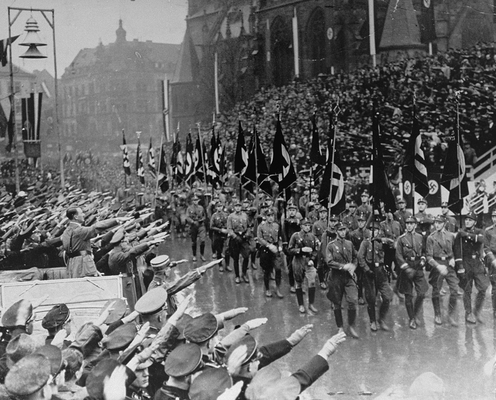 Adolf Hitler reviews SA troops during a parade in front of the town hall in Saarbrücken