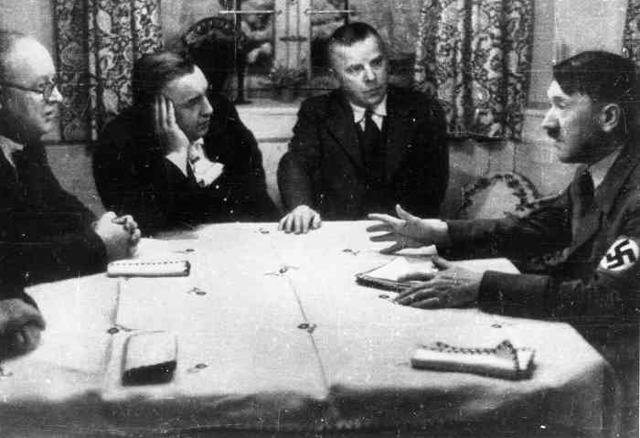 Adolf Hitler meets party publishers Max Amann and Adolf Müller and treasurer Franz Xaver Schwarz in Amann's house in St. Quirin
