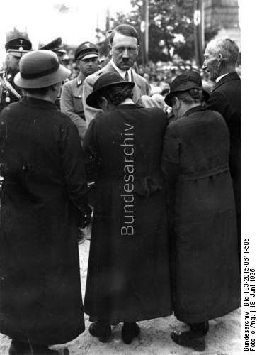 Adolf Hitler at the funeral ceremony for the 60 workers dead in the explosion of the factory in Reinsdorf