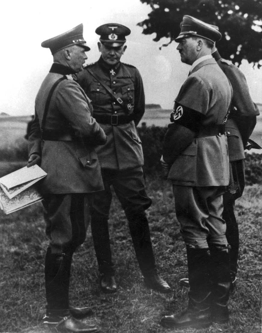 Adolf Hitler with minister of War Werner von Blomberg and Werner von Fritsch, commander in chief of the army, during army maneuvers at the Munster training camp