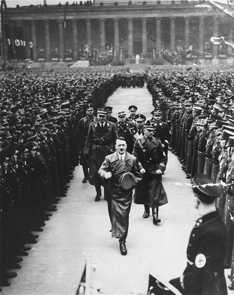 Viktor Lutze accompanies Adolf Hitler on a review of the army in Berlin to commemorate the third anniversary of Hitler's regime