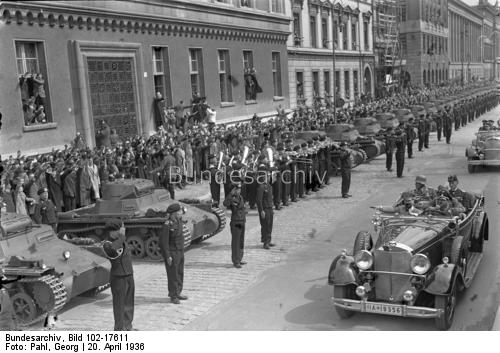 Adolf Hitler crosses Unter den Linden in his Mercedes and salutes Panzer troops on his 47th birthday