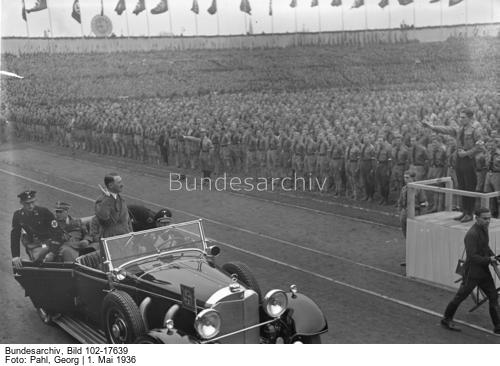Adolf Hitler arriving to give a May Day address at Berlin's Poststadion, salutes the HJ formation