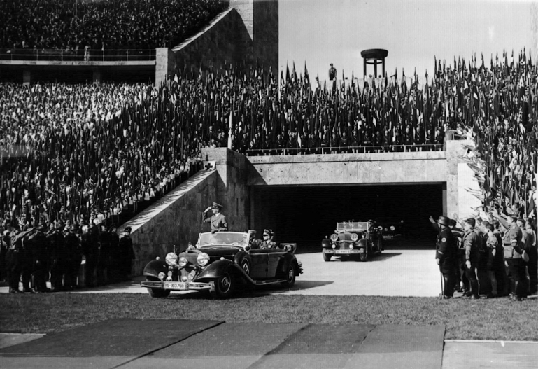 Adolf Hitler arrives in Berlin's Olympic stadium before his May Day address to the Hitlerjugend