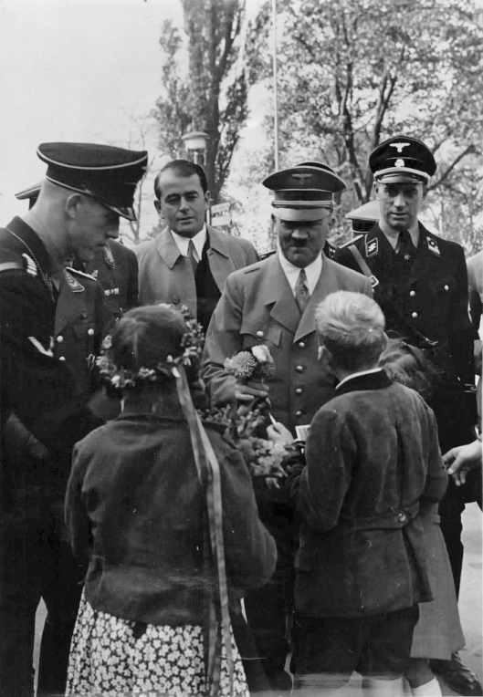 Adolf Hitler is welcomed by children before the exhibition 'Schaffendes Volk' in Düsseldorf