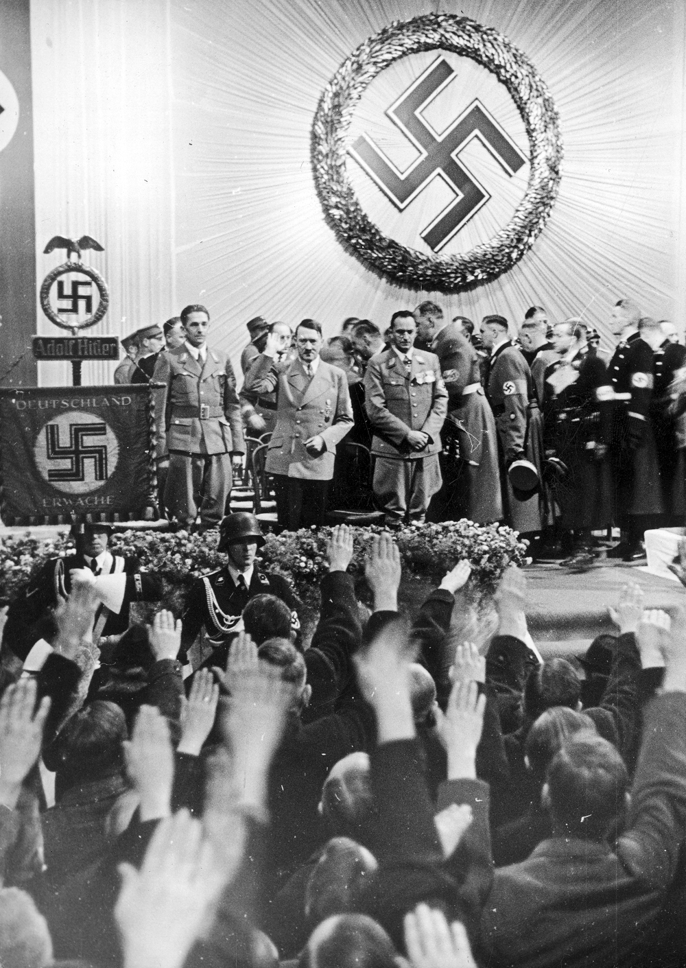 Adolf Hitler with Konrad Henlein and party members during his visit to the Sudetenland town of Reichenberg