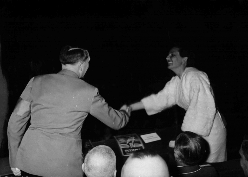 Adolf Hitler shaking hands with German actress and director Leni Riefenstahl at the premier of the film Olympia