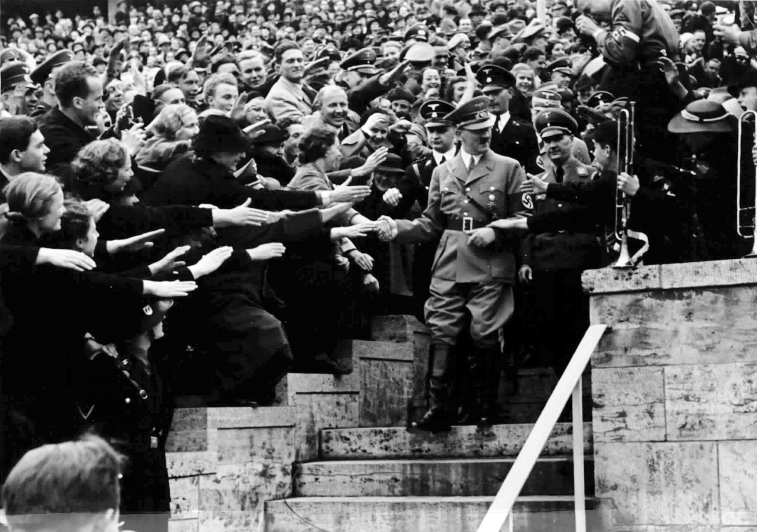 Adolf Hitler arrives at the Olympic stadium before his May day speech in Berlin
