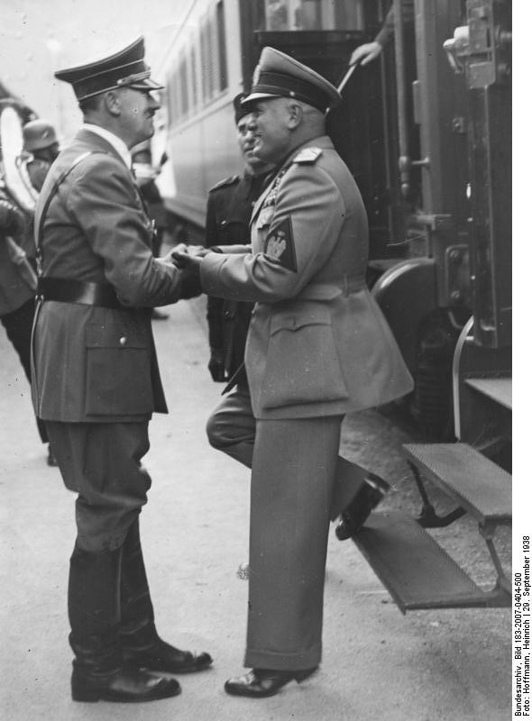 Adolf Hitler greets Benito Mussolini in Munich's station at their arrival before the Munich conference