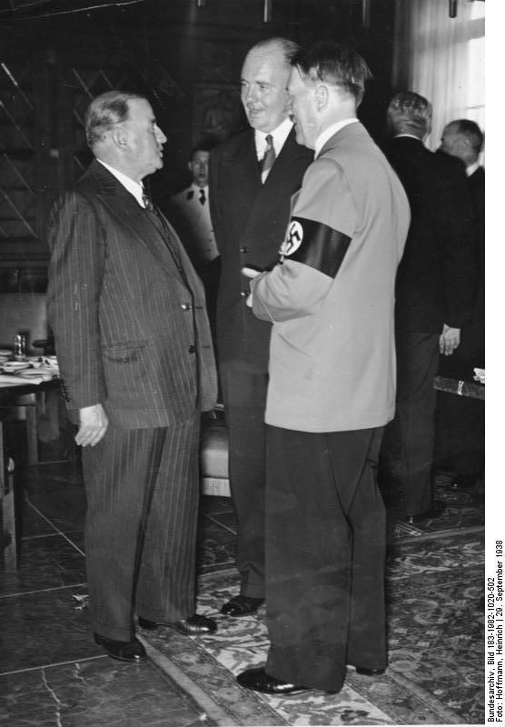 Daladier, the French Prime Minister, speaking to Hitler through interpreter Paul Schmidt, at the Munich Conference in München