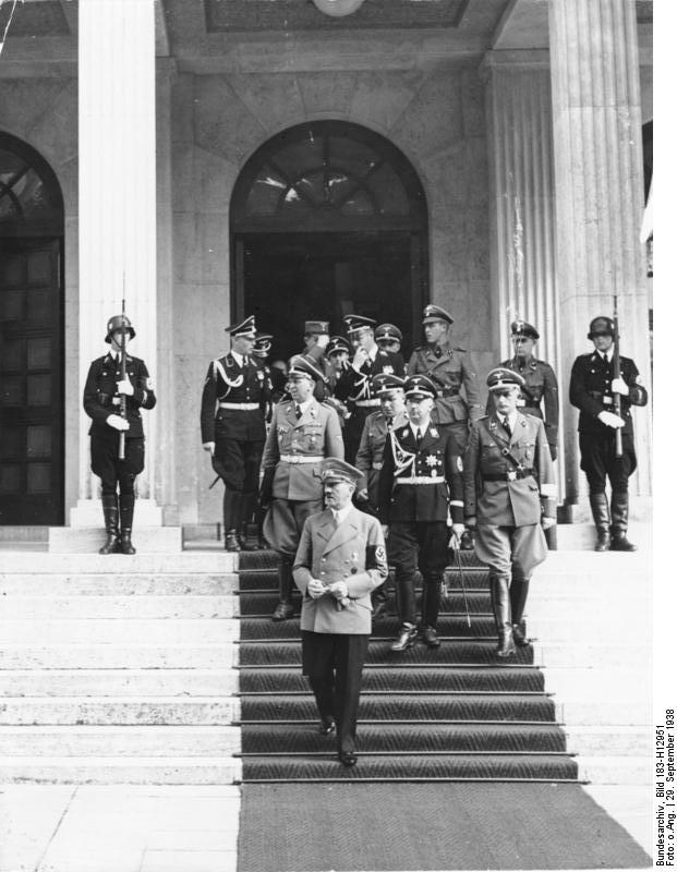 Adolf Hitler leaves the Führerbau in Munich for a pause during the negotiations