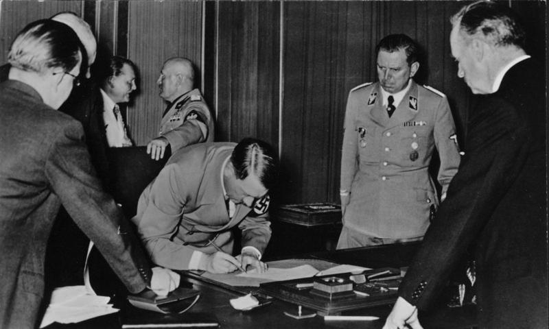 Adolf Hitler signing the Munich agreement after the negotiations