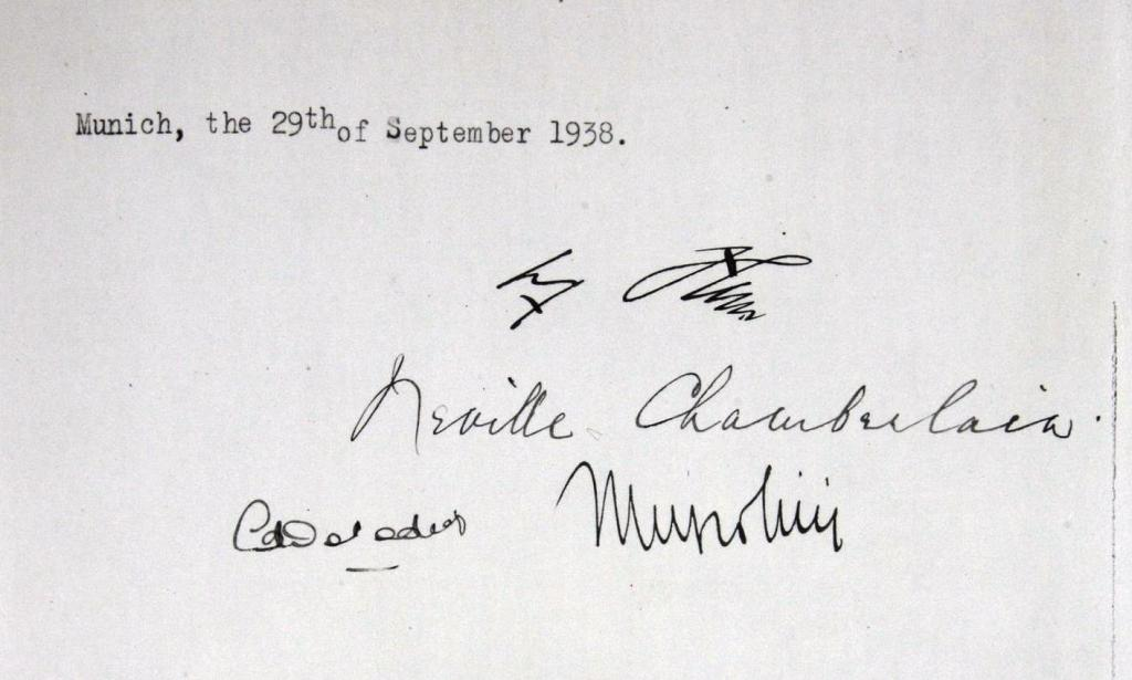 The Munich agreement is signed by Adolf Hitler, Neville Chamberlain, Edouard Daladier and Benito Mussolini, giving Germany the right to claim the Sudetenland