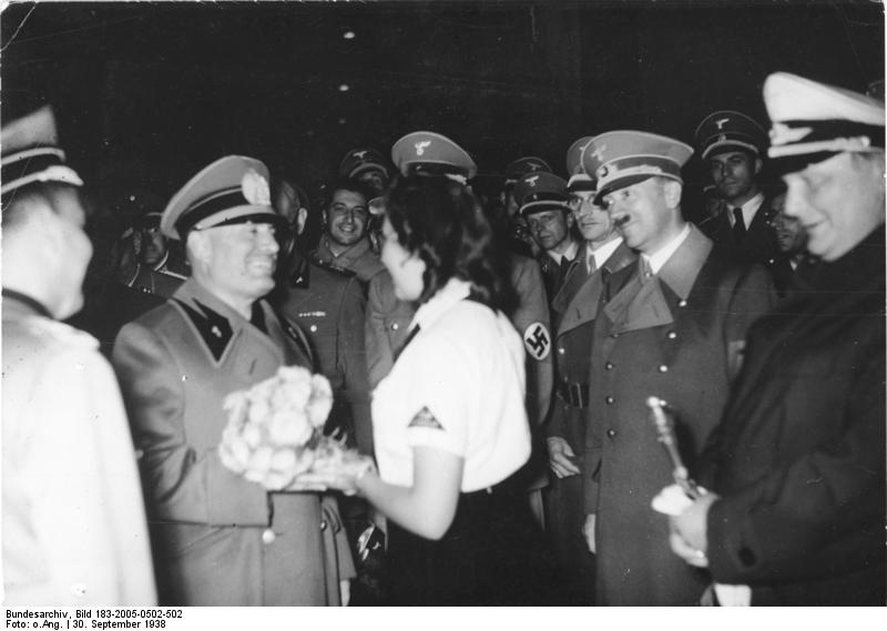 Benito Mussolini receives flowers from a BDM girl in Munich's station