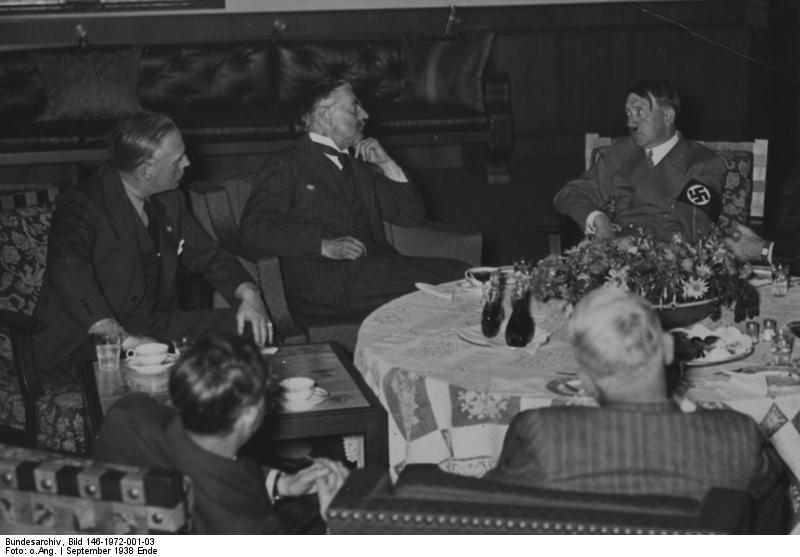British prime minister Neville Chamberlain, Joachim von Ribbentrop and Adolf Hitler at dinner during Chamberlain's 1938 appeasement visit to Munich