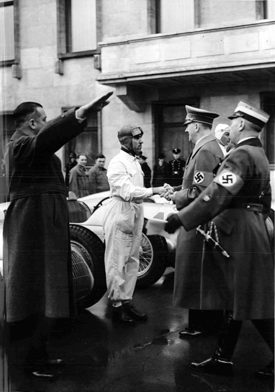 Adolf Hitler greets racing driver Tazio Nuvolari during the International Motor Show in Berlin