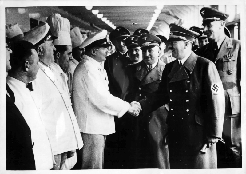 Adolf Hitler on board the Robert Ley KdF (Kraft durch Freude) ship greets crew members
