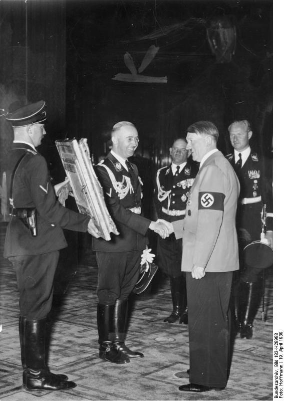 Heinrich Himmler offers Adolf Hitler a painting for his 50th birthday