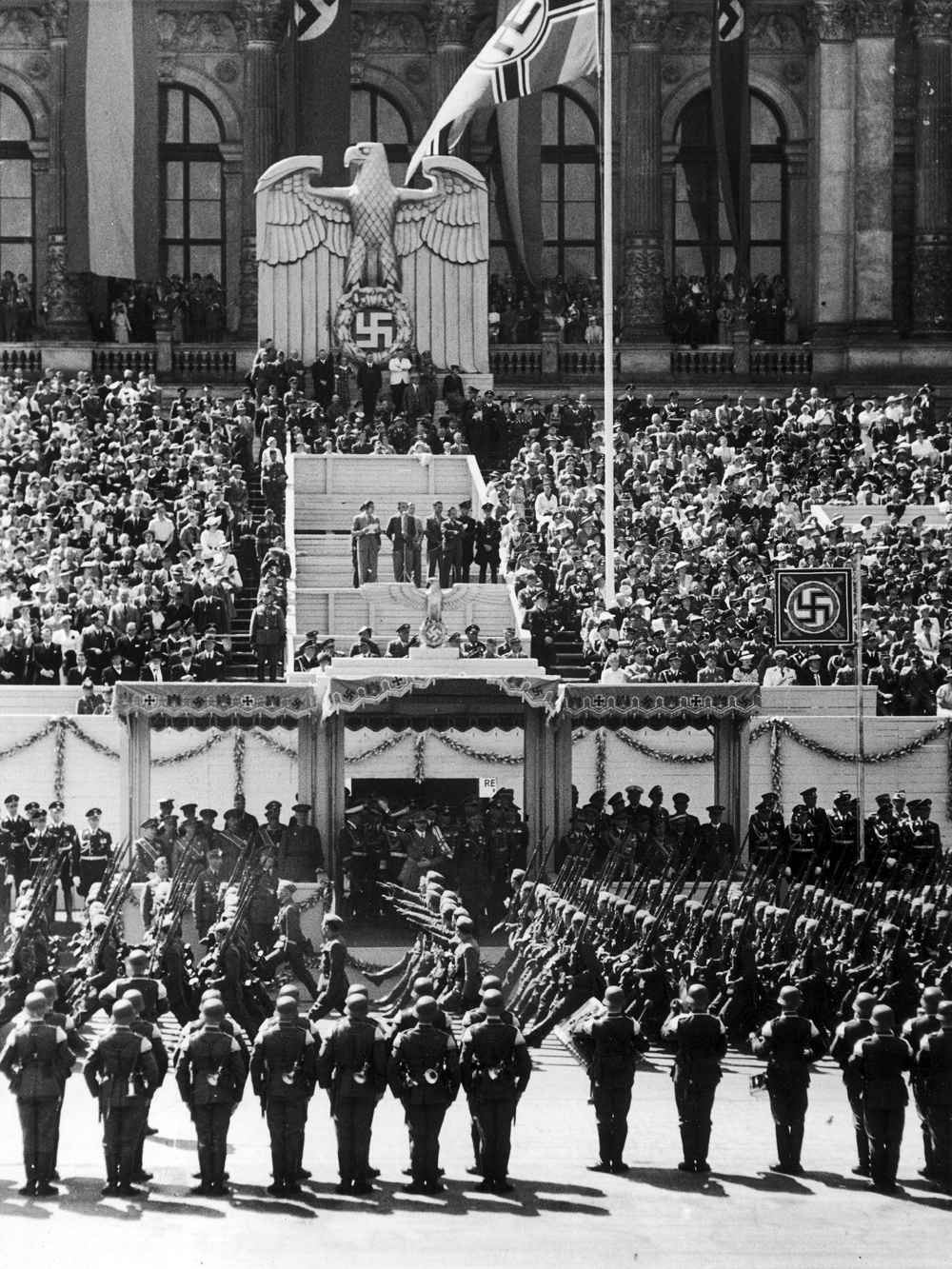 Parade of the Legion Condor in front of Berlin's Technische Hochschule in Charlottenburg, Adolf Hitler is in the tribune with officials and guests