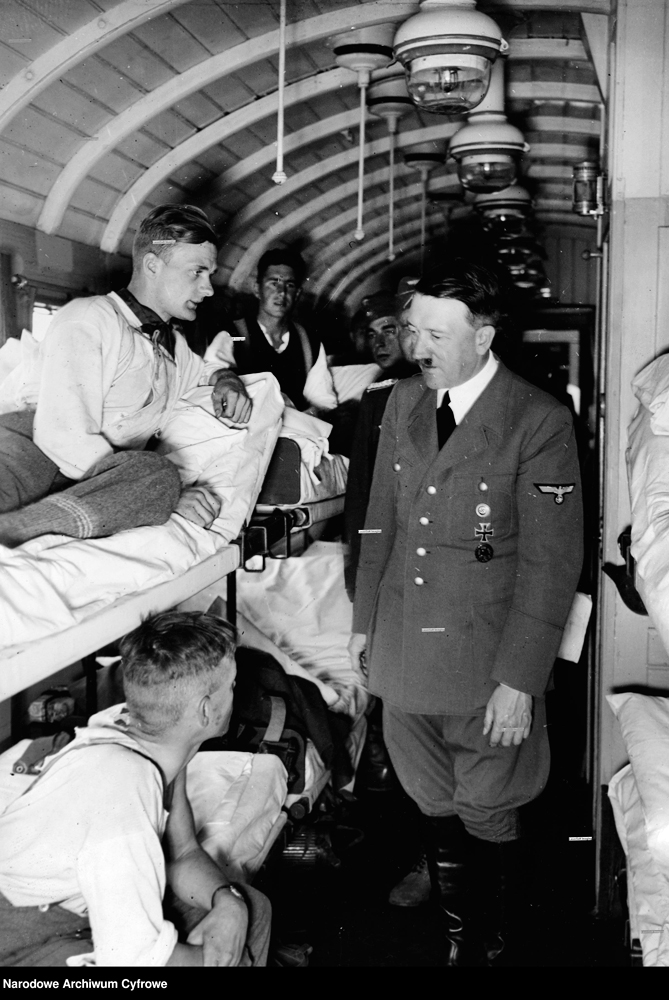 Hitler talking to wounded German soldiers in a sickbay near the eastern front in Poland