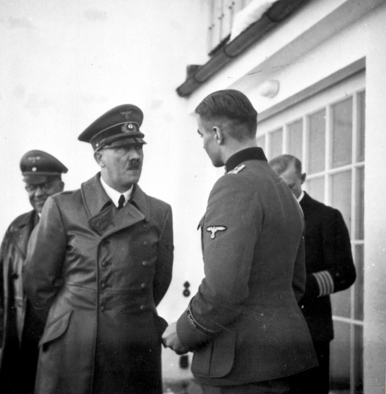 Adolf Hitler talking to Max Wünsche on the Berghof terrace early January 1940, from Eva Braun's albums