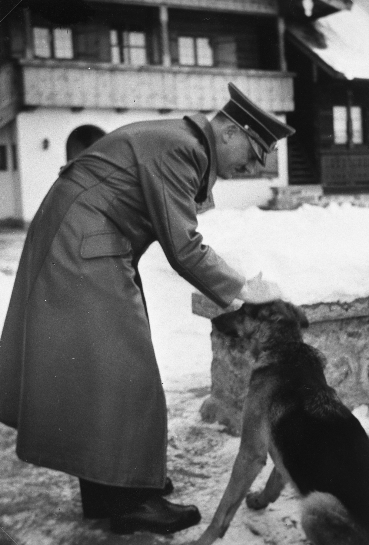 Adolf Hitler and his dog Wolf on the Berghof terrace early January 1940, from Eva Braun's albums