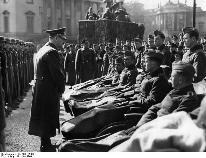 Adolf Hitler talks to wounded soldiers in Berlin for the Heldengetenktag