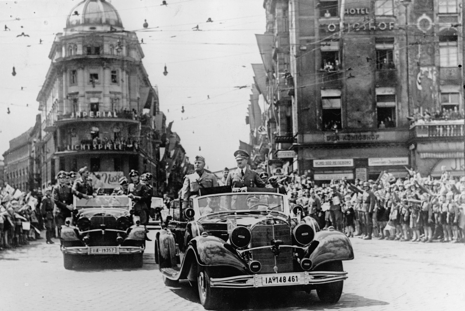 Adolf Hitler and Benito Mussolini on a car parade through Munich