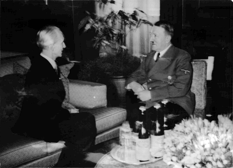 Adolf Hitler talking to foreign minister László Bárdossy (Hungary) in the Führerbau in Munich