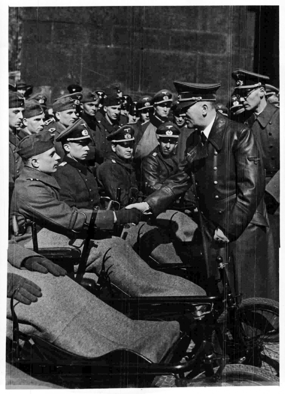 Adolf Hitler greets wounded soldiers during the Heldengedenktag (Heroes Memorial Day) in Berlin