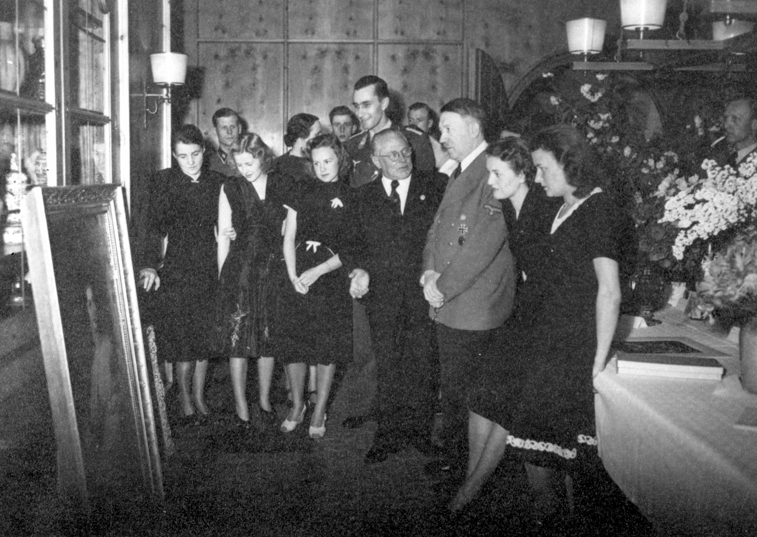 Adolf Hitler and Eva Braun look at a gift painting on the occasion of the 54th birthday of the Führer, from Eva Braun's albums