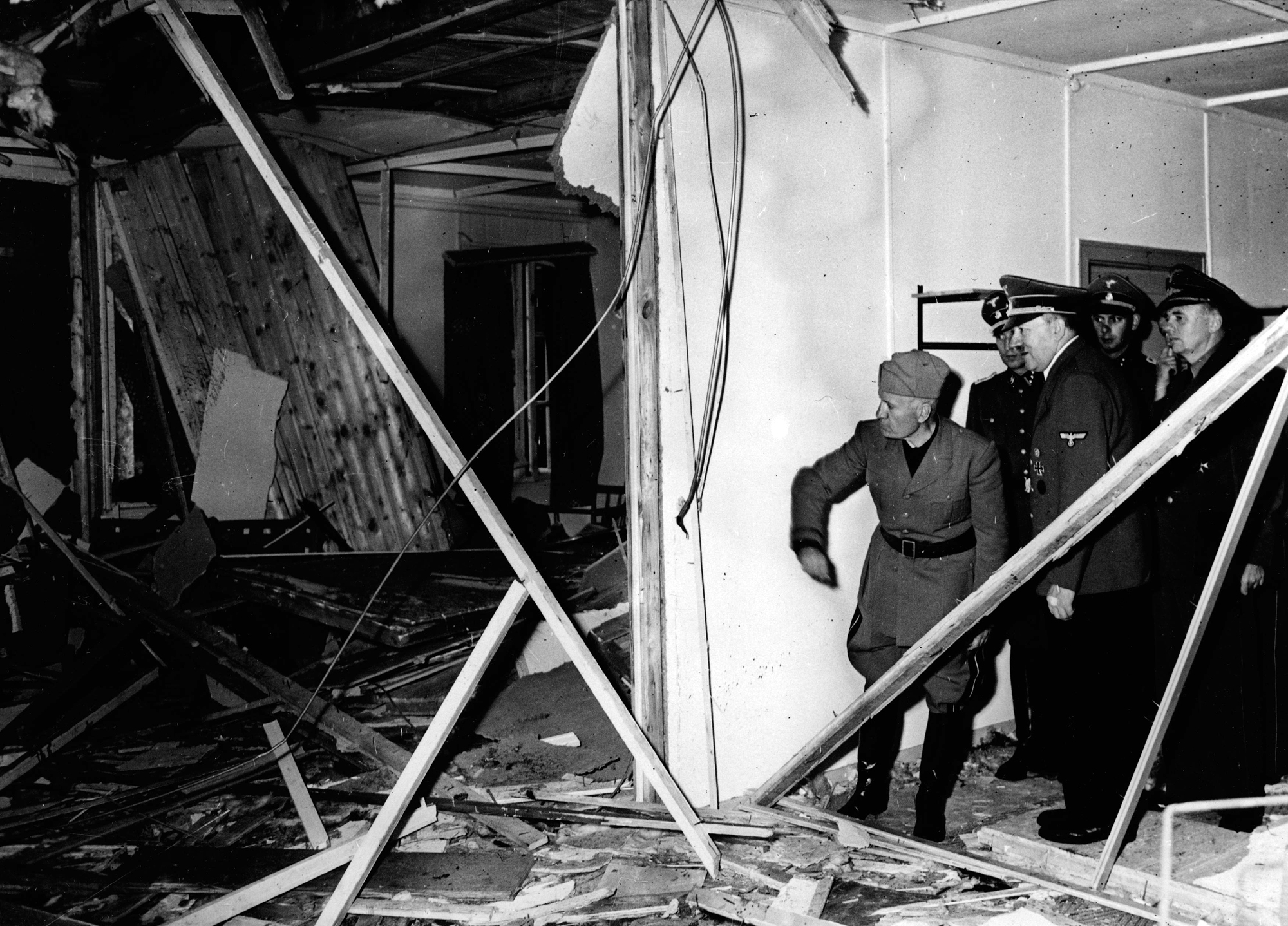 Mussolini and Hitler inspect the wreckage of the conference room