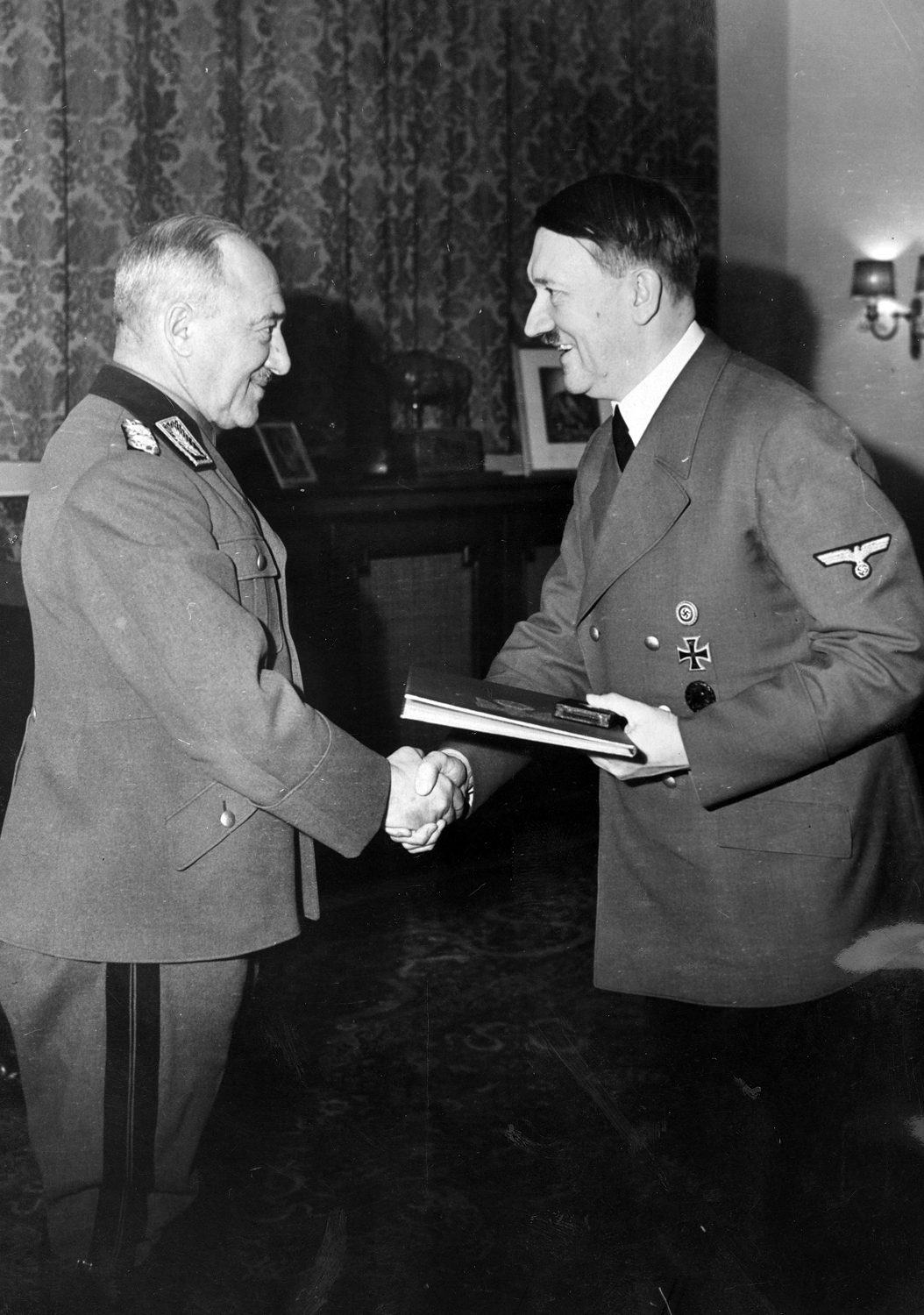 Reichsarbeitsfuehrer Hierl gets the War Merit Cross (First Class) with swords from Adolf Hitler