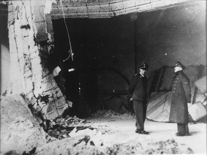 Adolf Hitler observes the ruins of the chancellery with his adjutant Julius Schaub